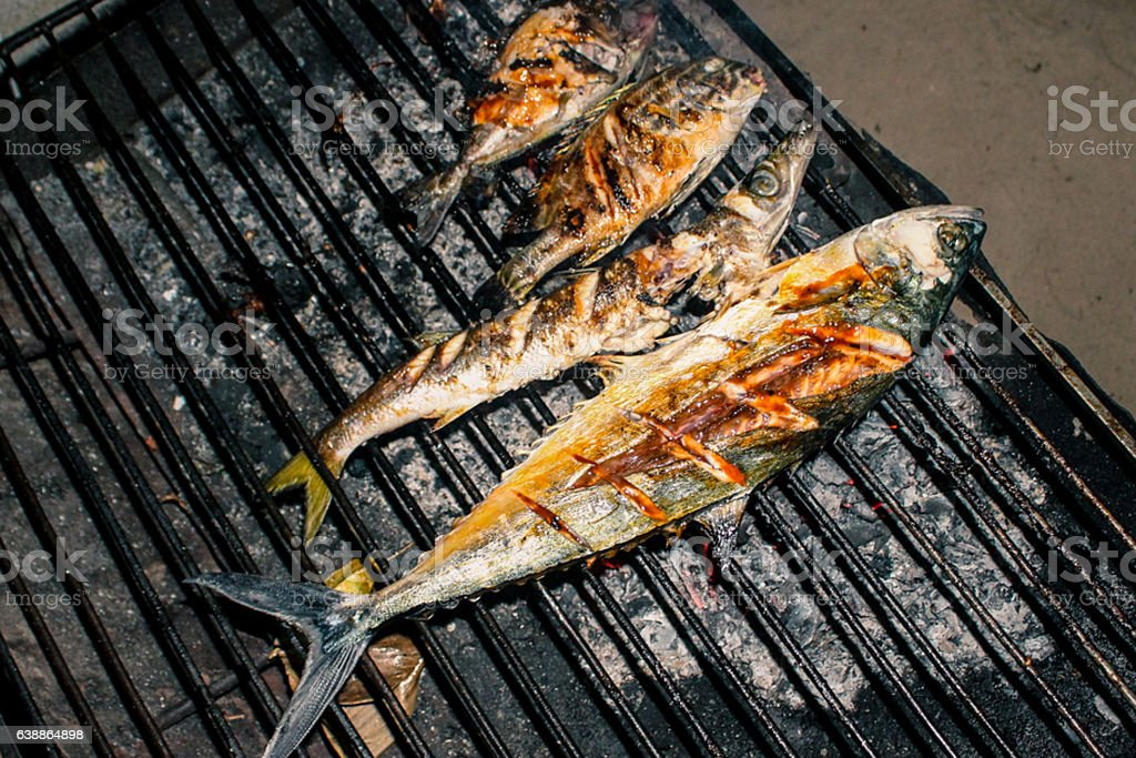 Grilled fish on barbeque grill stock photo