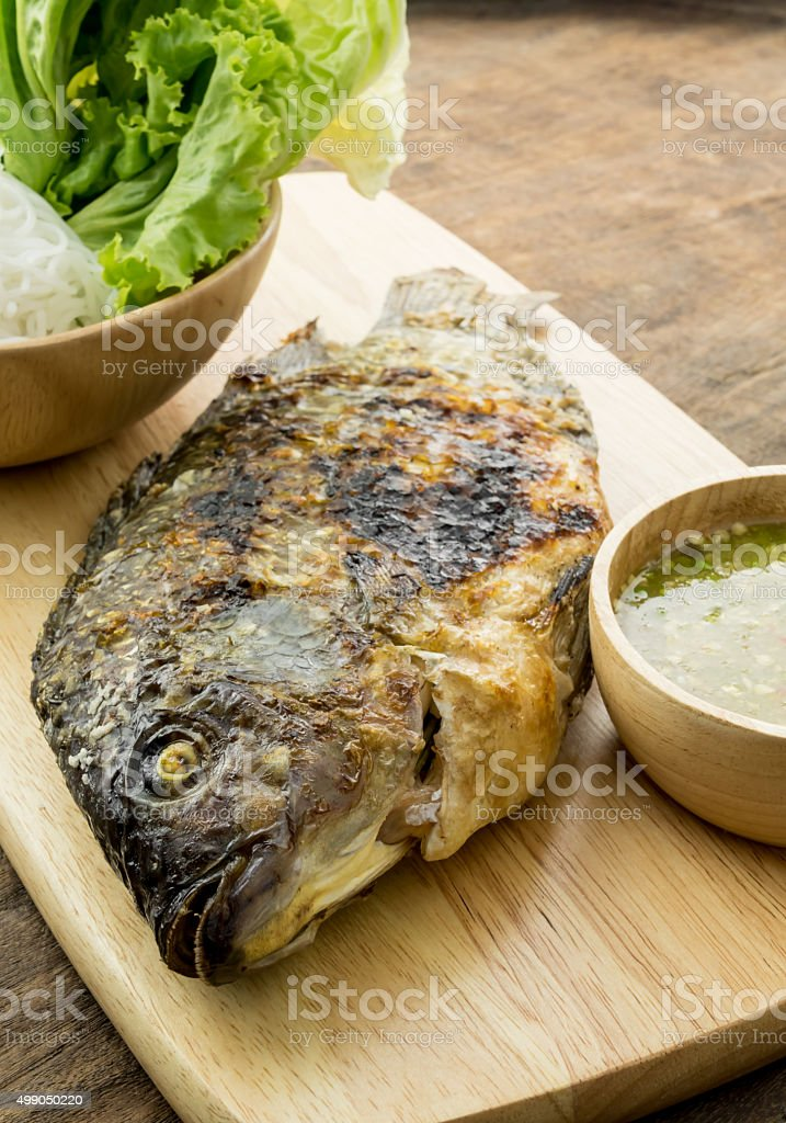 Grilled fish Served on Wooden board stock photo