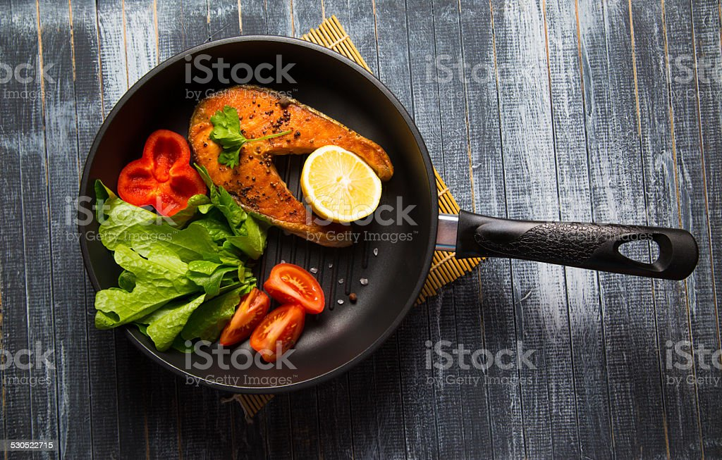 Grilled fish steak with vegetables stock photo