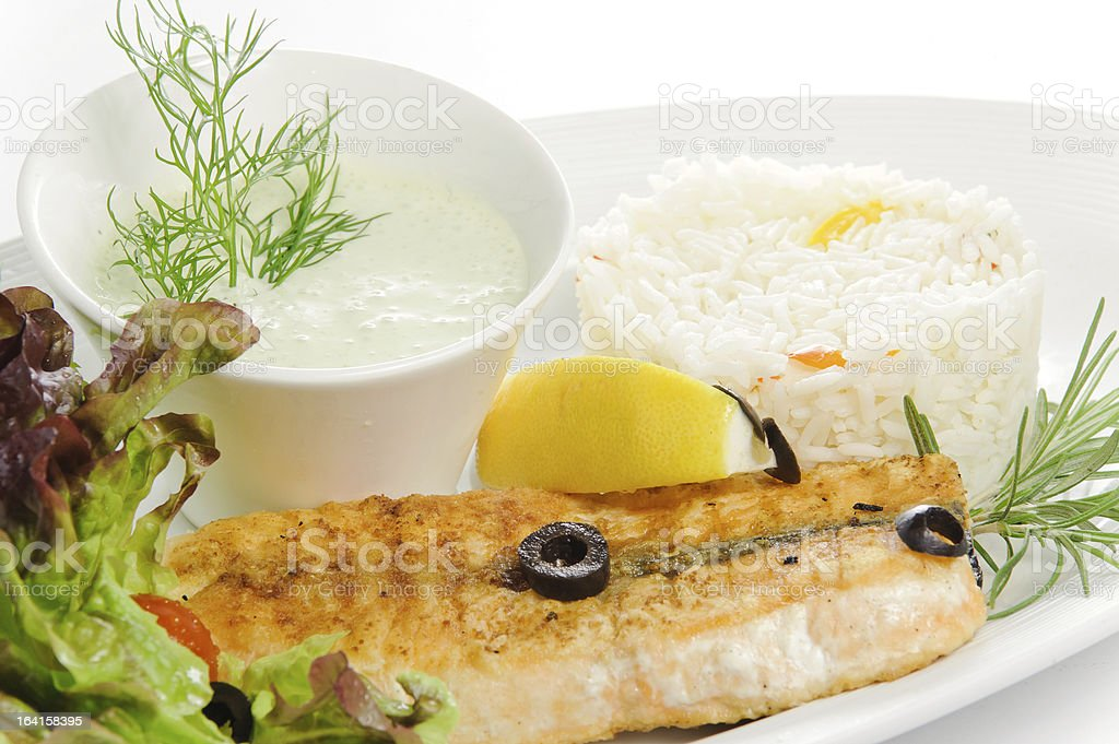 Grilled fish with garnish ris royalty-free stock photo