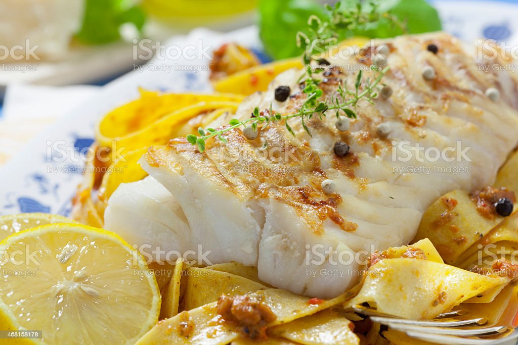 Grilled fish with Italian noodles stock photo