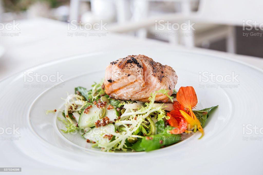 Grilled fish with vegetable at restaurant stock photo