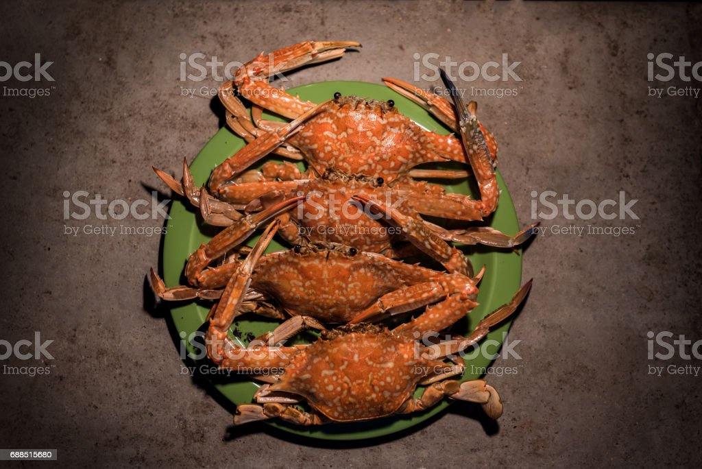 Grilled flower crabs at campfire. stock photo