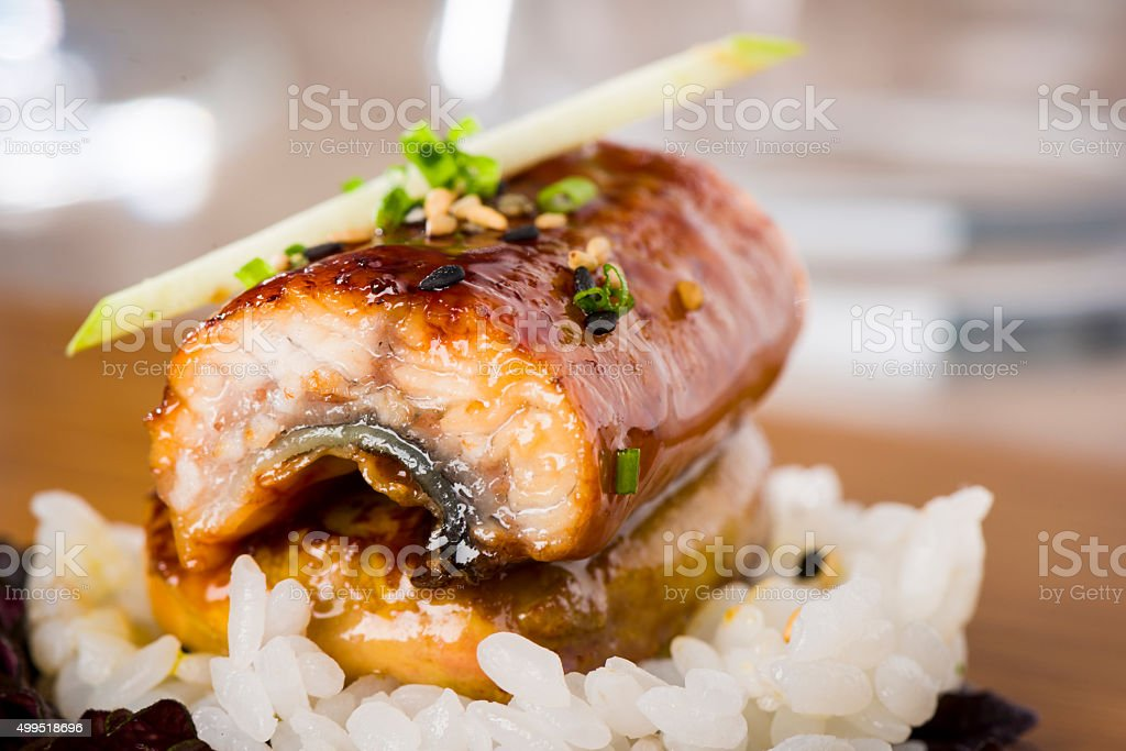 Grilled foiegrass, glazed eel, sushi rice stock photo