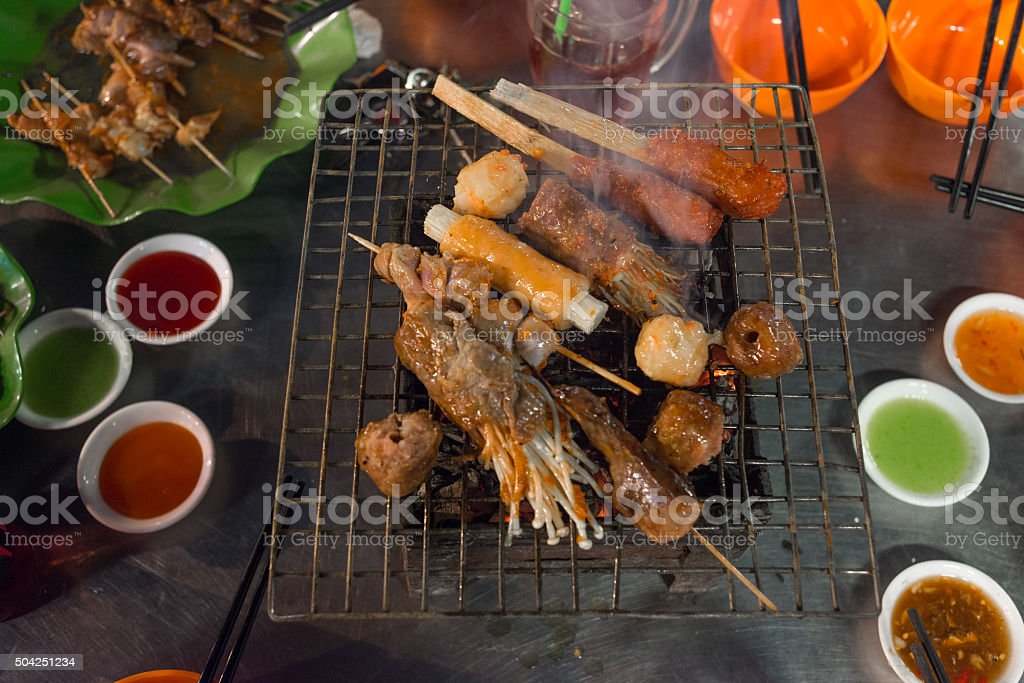 Grilled food and sauce on table ready for BBQ party stock photo