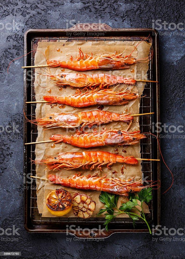 Grilled fried prawns shrimps on skewers stock photo