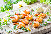 Grilled fried Shrimps Prawns on wooden skewers with spices
