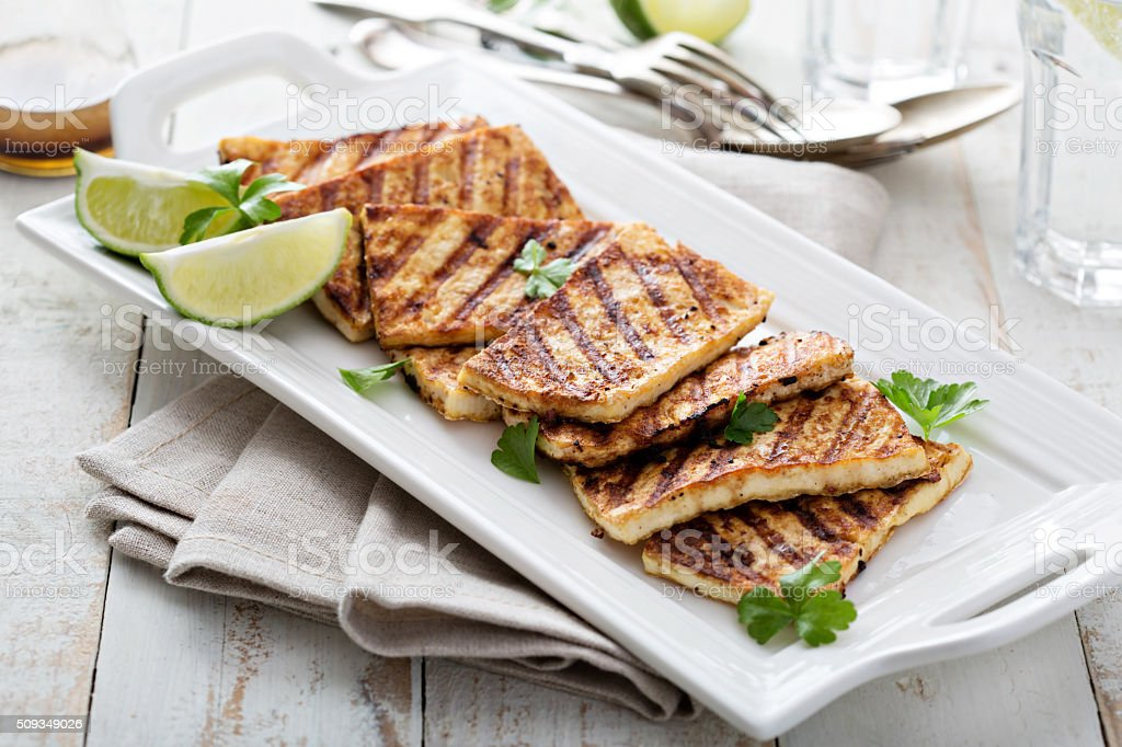 Grilled fried tofu on a plate stock photo
