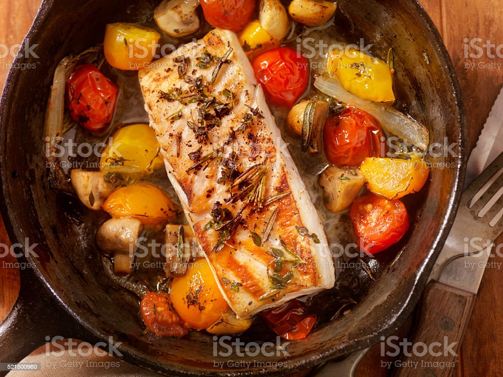 Grilled Halibut Fillet with Tomatoes and Mushrooms stock photo
