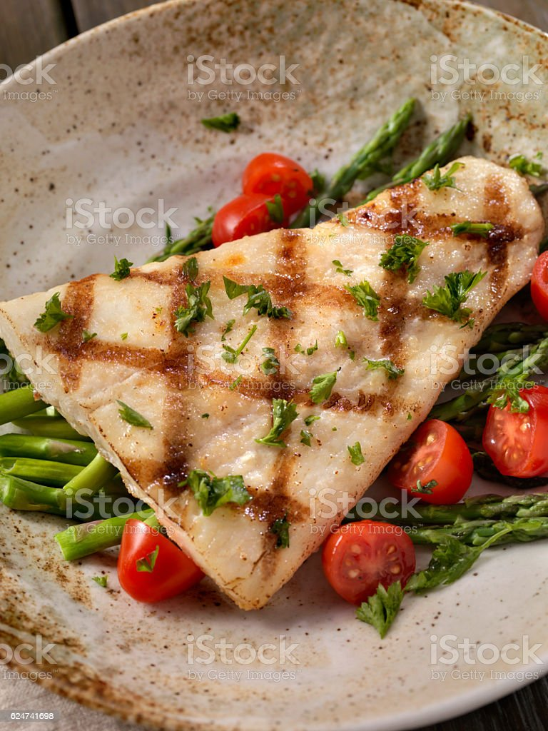 Grilled Halibut with Asparagus and Tomatoes stock photo