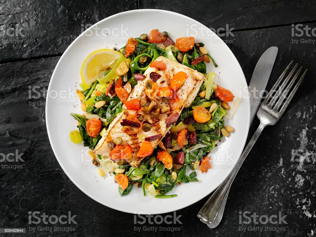 Grilled Halibut with Capers,Olives and Tomatoes stock photo