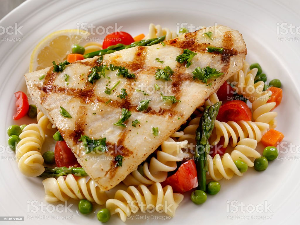 Grilled Halibut with Rotini Primavera stock photo