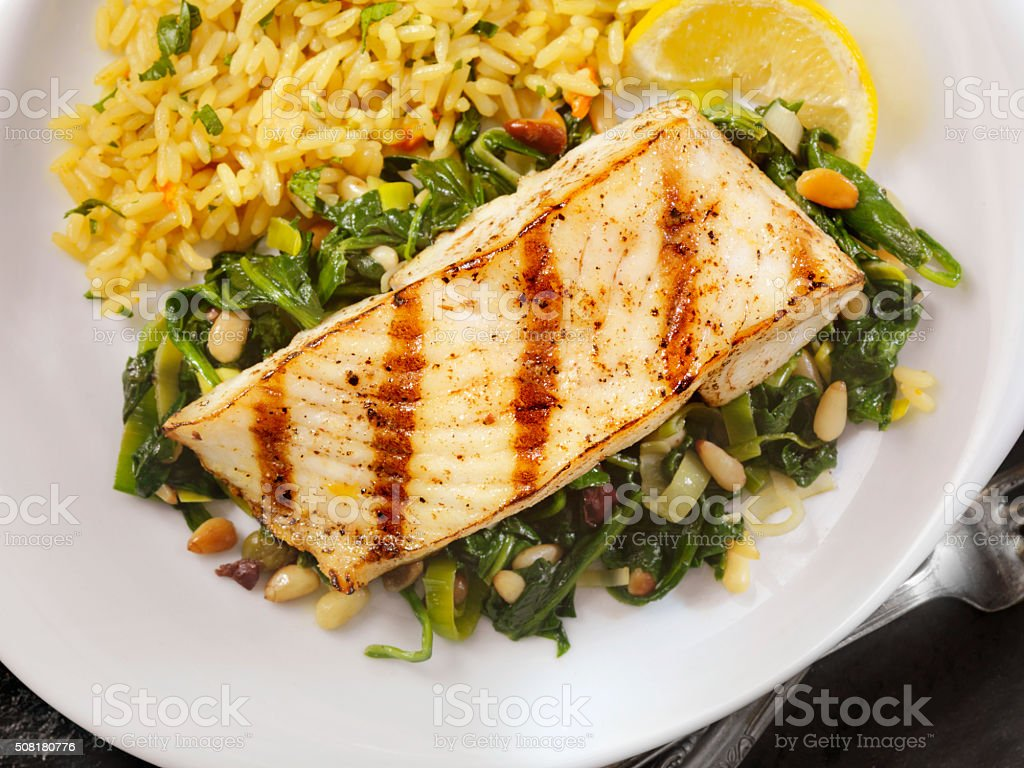 Grilled Halibut with Spinach, leeks and Rice stock photo