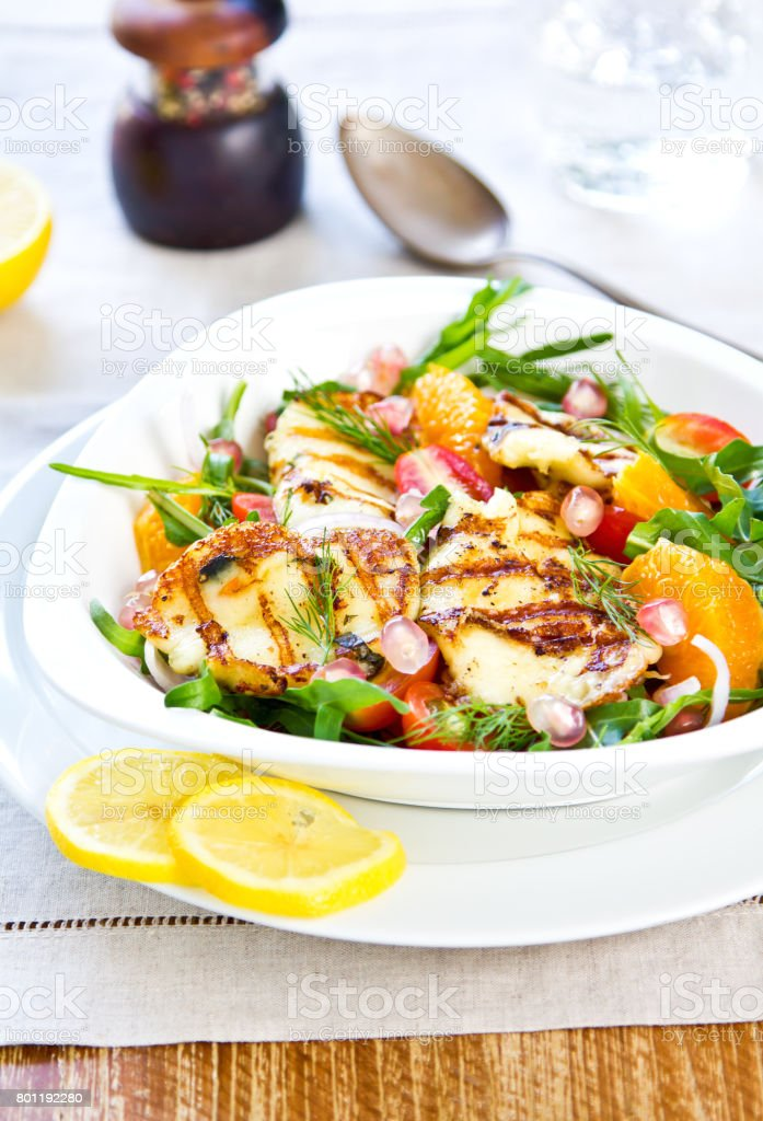 Grilled Halloumi with Pomegranate,Orange and Rocket salad stock photo