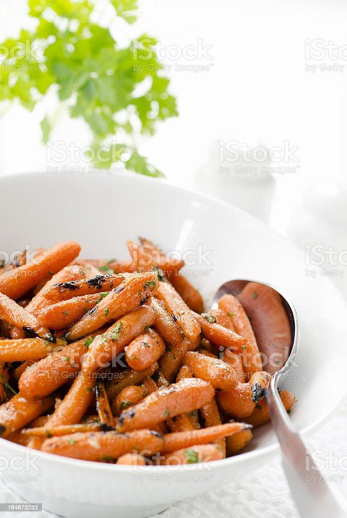 Grilled Honey Glazed Baby Carrots with Copy Space stock photo