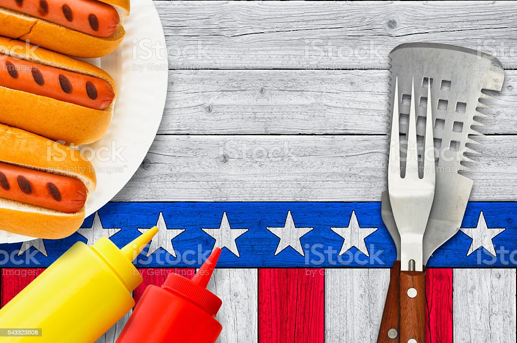 Grilled Hotdogs Paper Plate with Ketchup Mustard Bottles Patriotic Background stock photo