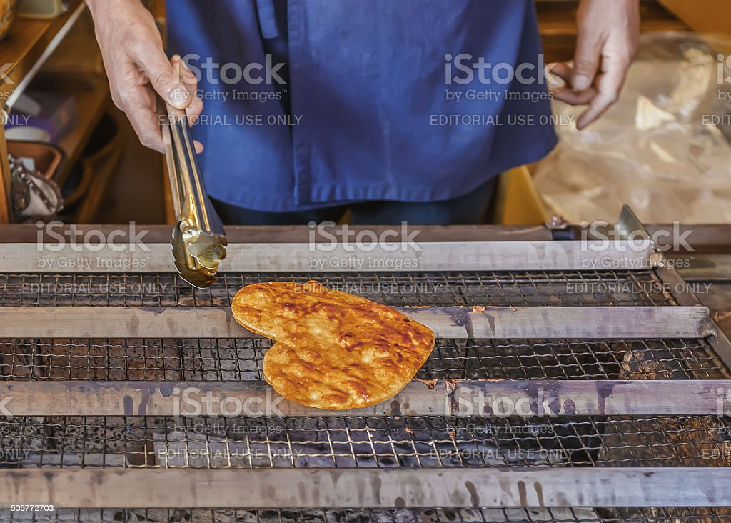Grilled Japanese Senbei on a stove stock photo