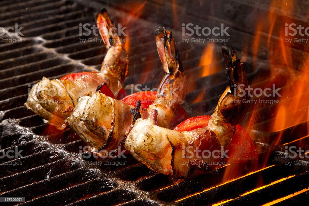 Grilled Jumbo Bacon Wrapped Shrimp and Tomatoes stock photo