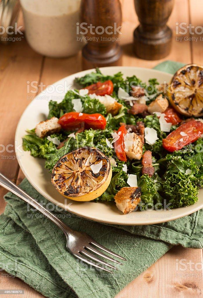 Grilled Kale Caesar Salad stock photo