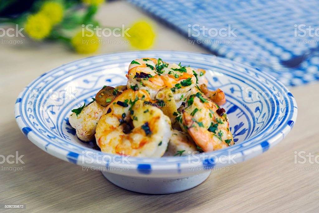 Grilled King Prawns are in Porcelain Plate stock photo