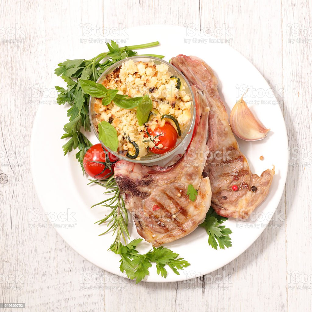 grilled lamb chop and vegetable crumble stock photo