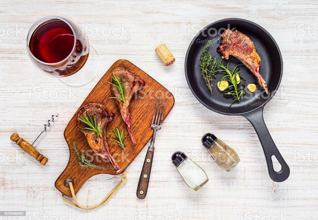 Grilled Lamb Chops with Red Wine and Frying Pan stock photo