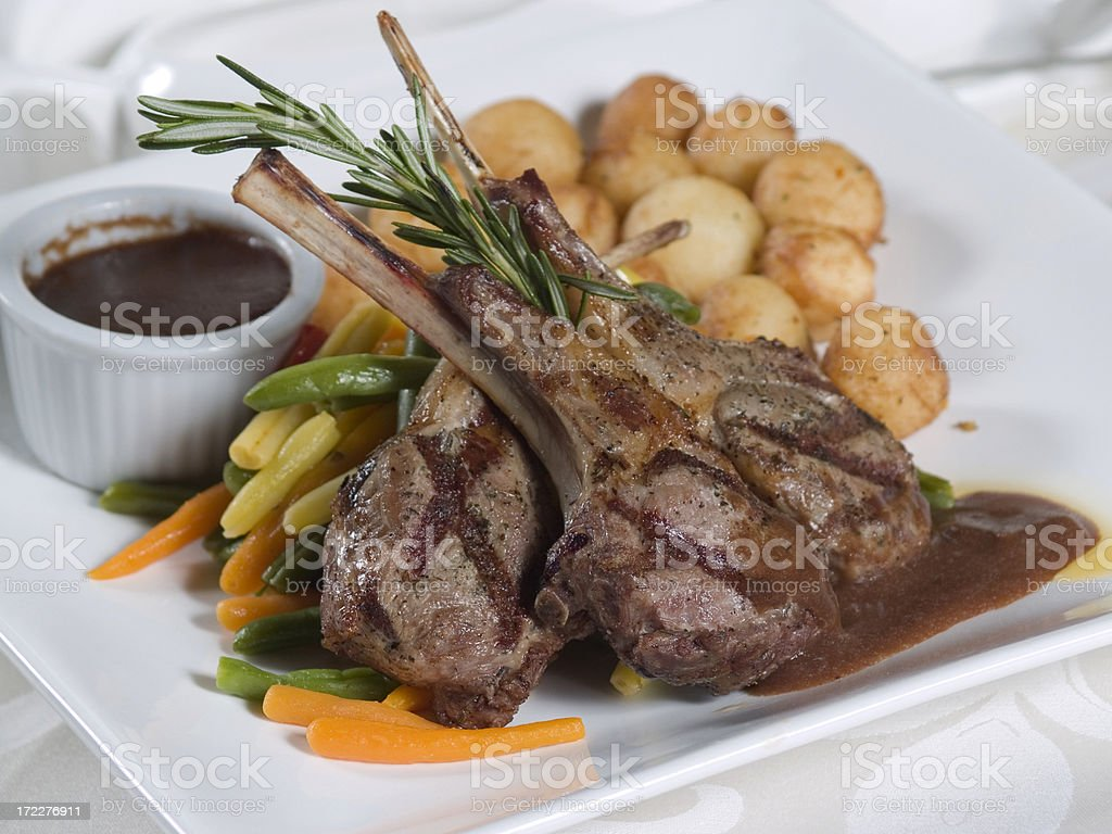 Grilled lamb chops with vegetables and potatoes royalty-free stock photo