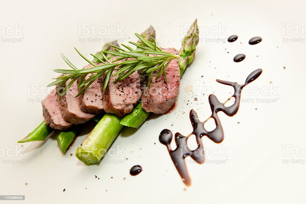 Grilled Lamb Filet on a bed of Green Asparagus royalty-free stock photo