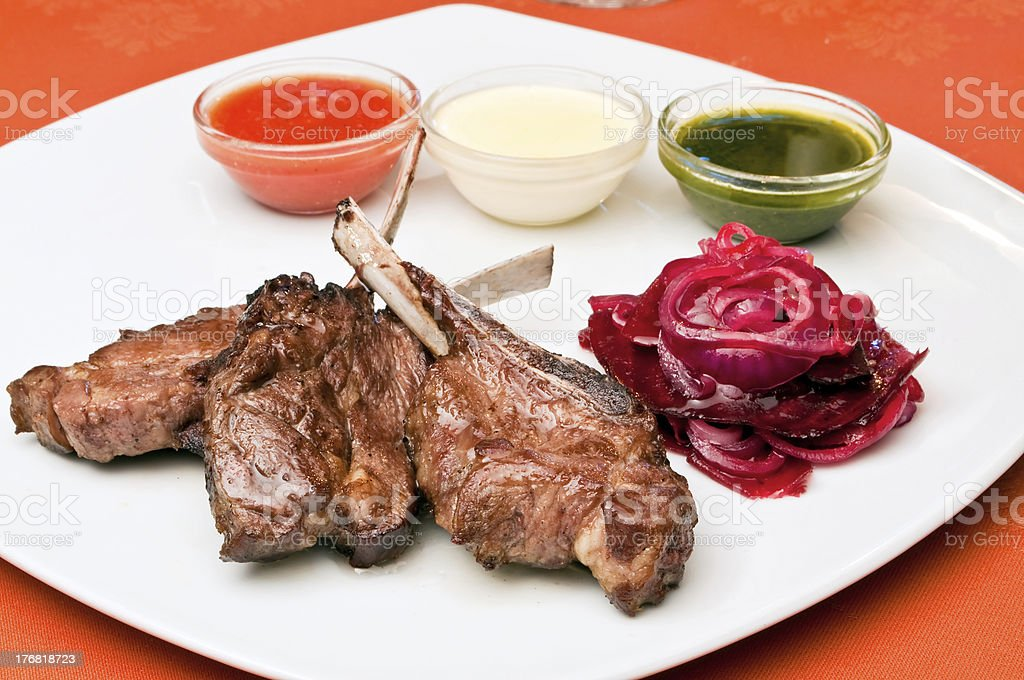 Grilled lamb ribs with beet-root carpaccio royalty-free stock photo
