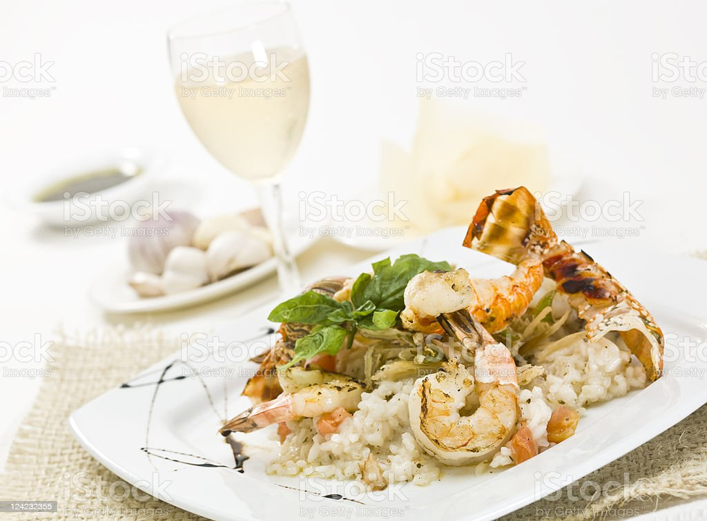 Grilled lobster and prawns risotto stock photo