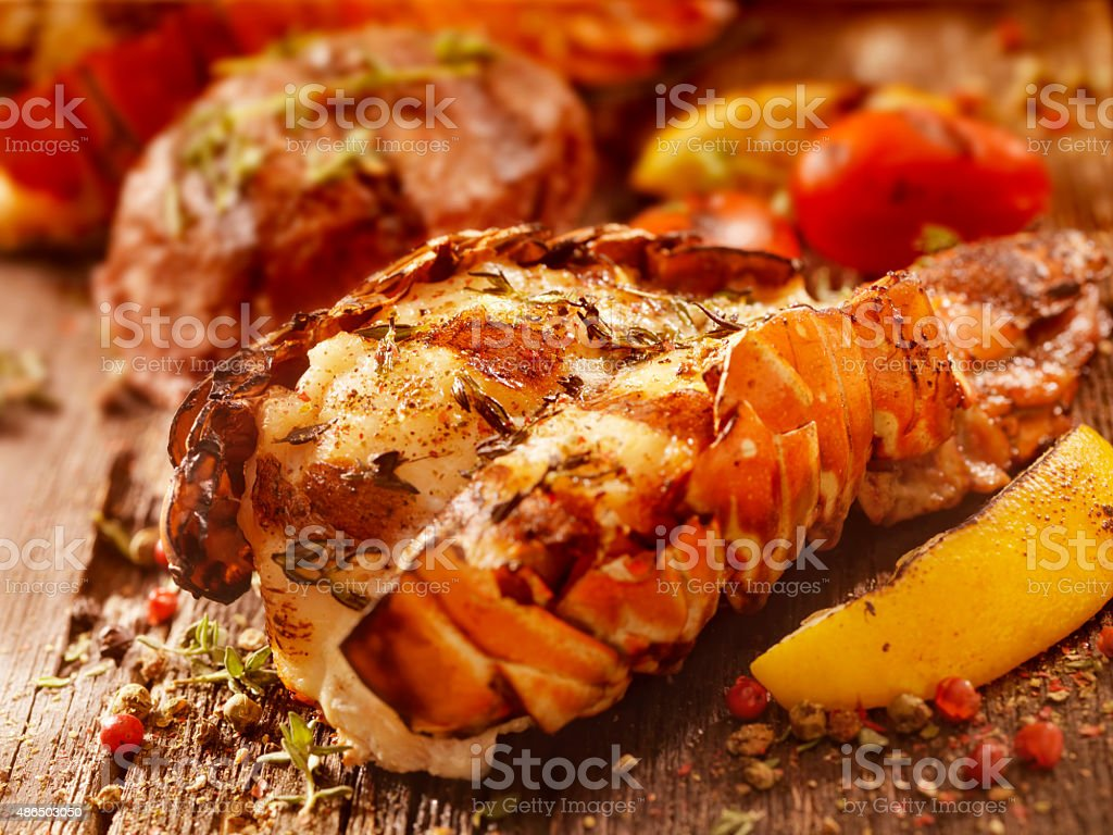 BBQ Grilled Lobster Tail and Steak Fillet stock photo