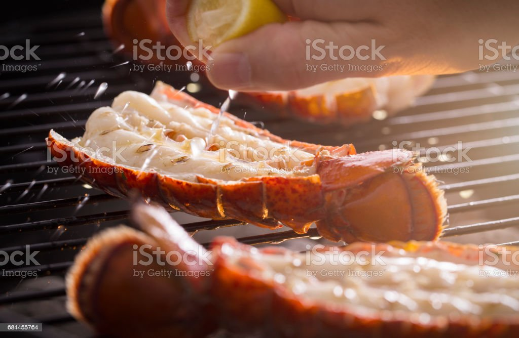 Grilled Lobster Tail on the Grill with Lemon stock photo