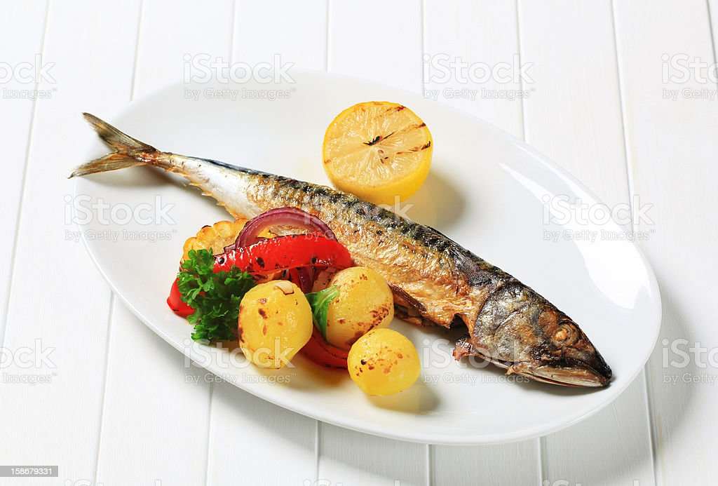Grilled mackerel and potatoes royalty-free stock photo