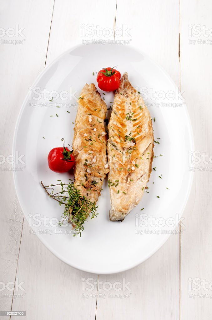 grilled mackerel with thyme and tomato stock photo