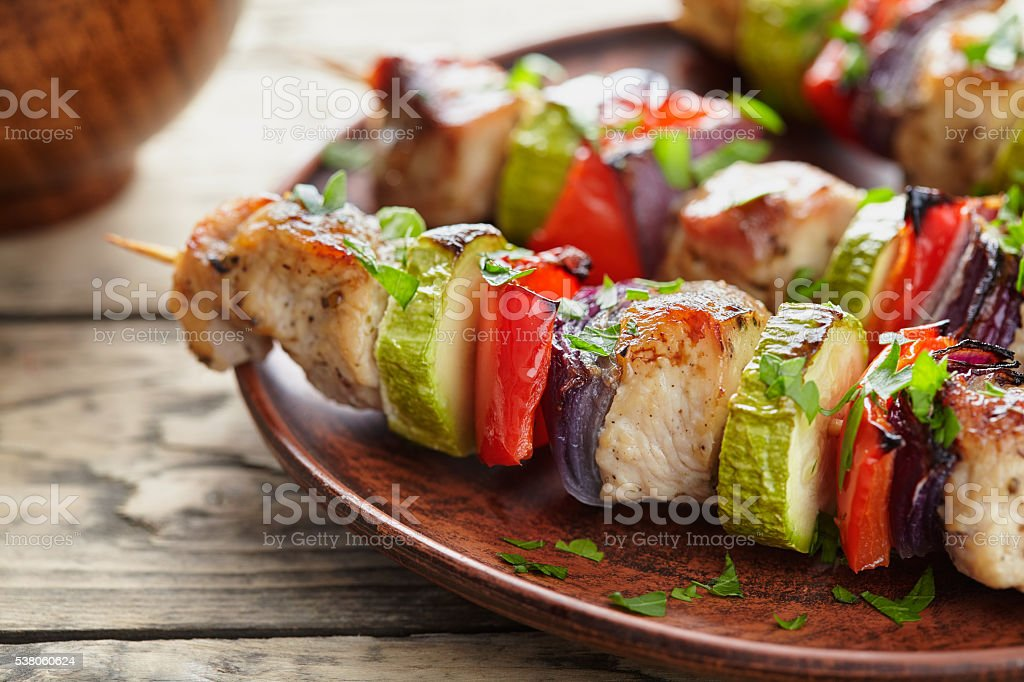 Grilled marinated turkey or chicken meat shish kebab skewers stock photo