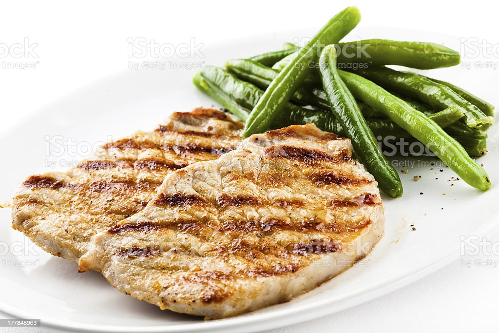 Grilled meat and grean bean royalty-free stock photo