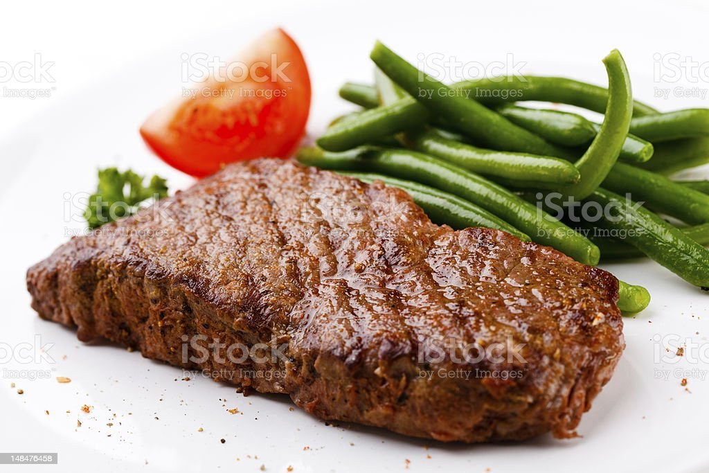 Grilled meat and green beans royalty-free stock photo