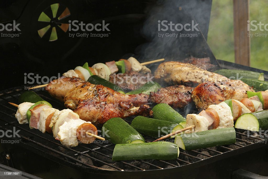 BBQ grilled meat and sticks royalty-free stock photo