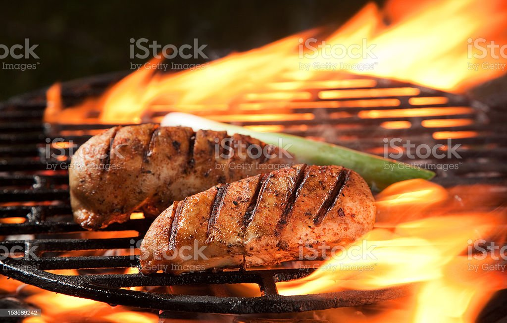Grilled meat on a grill stock photo
