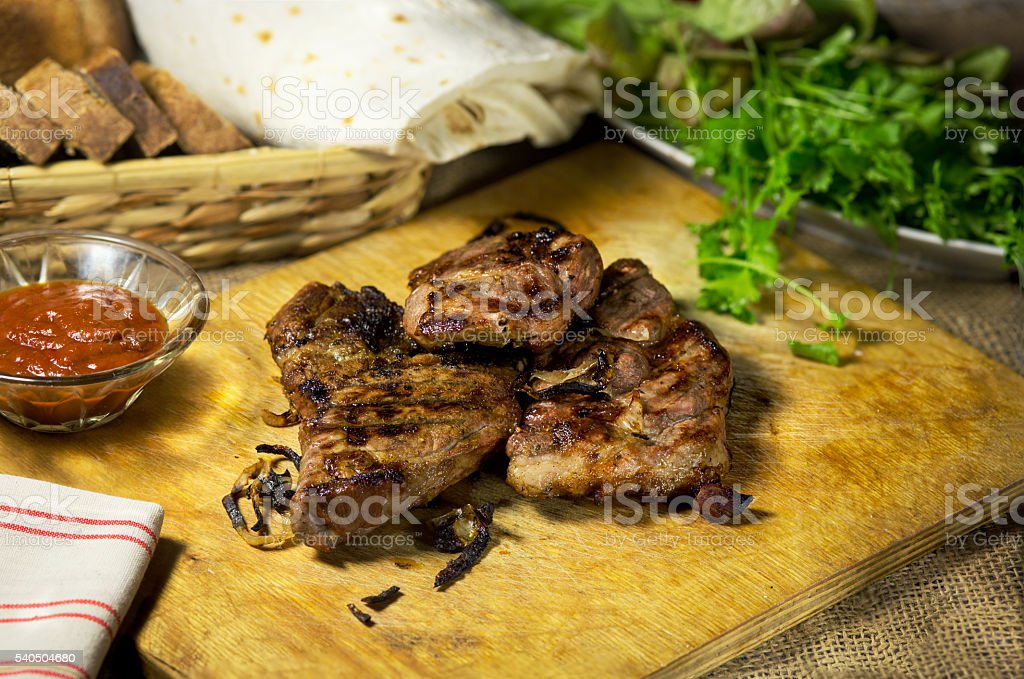 Grilled meat on a laid table stock photo
