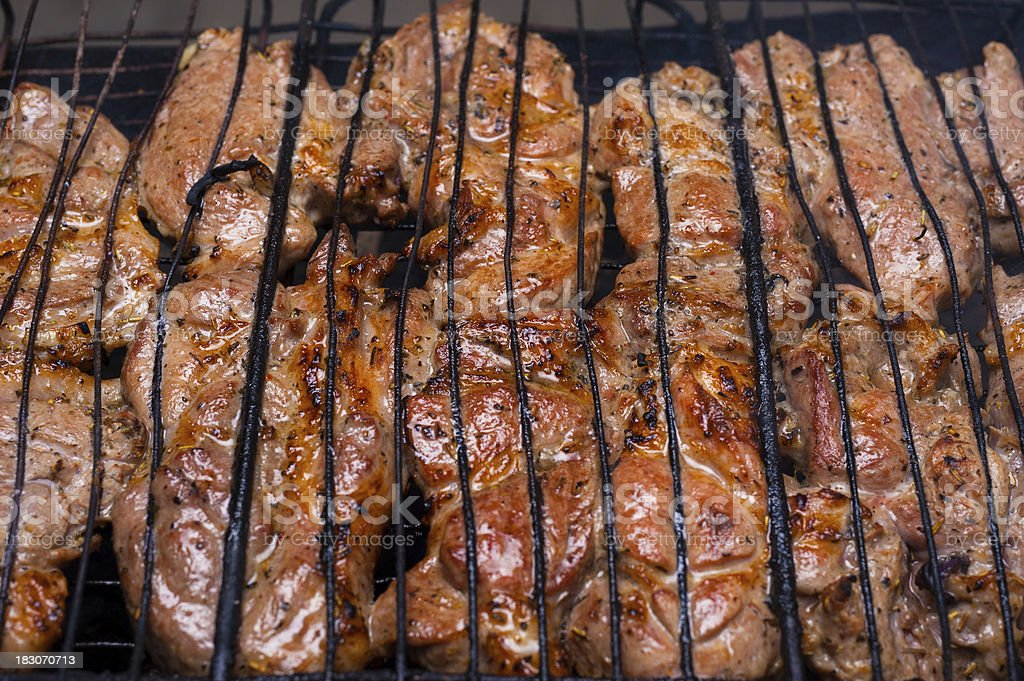 grilled meat on grill royalty-free stock photo