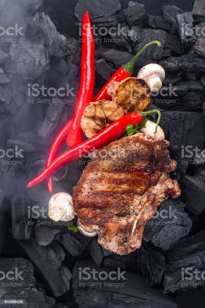 Grilled meat on the coals background stock photo