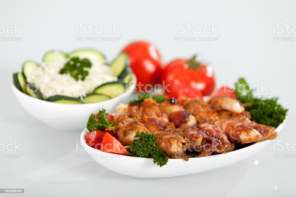 Grilled meat on wood sticks with salad royalty-free stock photo
