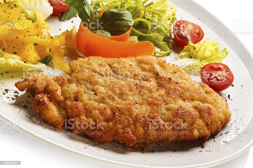 Grilled meat, potatoes and vegetables royalty-free stock photo