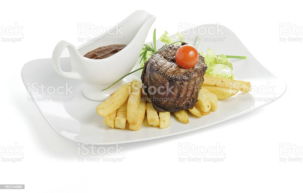 Grilled meat with fries and sauce royalty-free stock photo