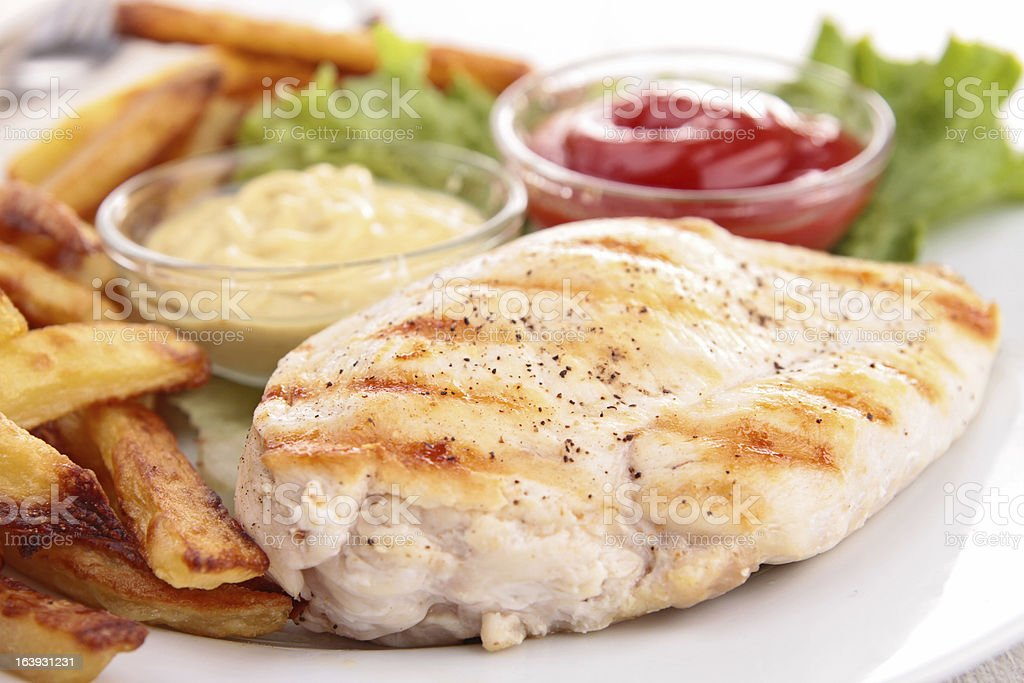 grilled meat with vegetable, and french fries stock photo