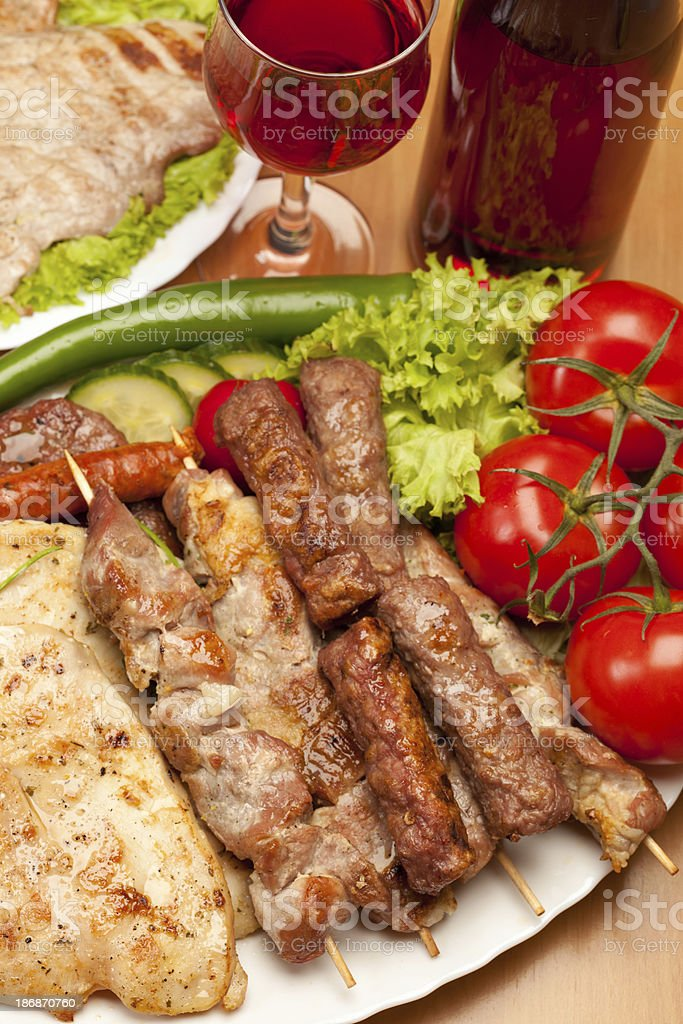 Grilled meat with vegetables and red wine royalty-free stock photo