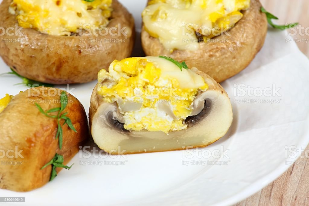 Grilled mushroom filled with eggs and cheese stock photo