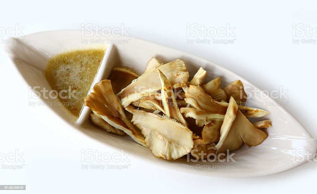 Grilled mushrooms in plate with spicy sauce stock photo