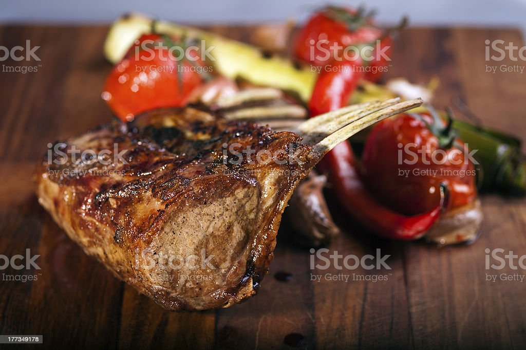 grilled mutton chops on cutting board stock photo